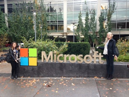 employees in front of microsoft sign